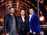 Actor Tiger Shroff with filmmakers Rohit Shetty and Karan Johar at Filmistan Studio in Mumbai on March 20, 2018.