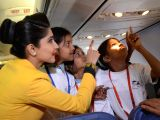 An air hostess with the children during  Flight of Fantasy organised for children by Jet Airways ahead of Childrens Day at Chhatrapati Shivaji International Airport in Mumbai on ...