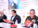 Army Chief General Bipin Rawat, Union MoS Defence Subhash Ramrao Bhamre and FICCI Secretary General Sanjaya Baru during a FICCI seminar on Solution to Problem Statements in New ...
