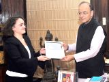 Banker Magazine Asian Editor Spesania Palma presents to Union Minister for Finance and Corporate Affairs Arun Jaitley for the Best Finance Minister Award of Global as well as Asia Pacific, ...