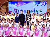BEIJING, Nov. 9, 2017 - Peng Liyuan, wife of Chinese President Xi Jinping, and U.S. First Lady Melania Trump, pose for a group photo with students after watching their performances at Banchang ...