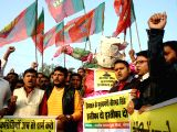 Bhartiya Janata Yuva Morcha (BJYM) activists stage a demonstration protesting against the UPA government, Prime Minister Manmohan Singh on price hike of cooking gas in Bhopal on Jan 2, 2014. They ...