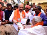 BJP chief Amit Shah during an election campaign ahead of Gujarat Assembly polls in Ahmedabad on Nov 7, 2017.