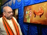 BJP chief Amit Shah looks at paintings exhibited at an exhibition on Prime Minister Narendra Modis achievement in Bengaluru on Jan 9, 2018.