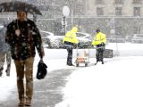 BRUSSELS, Dec. 11, 2017 - A pedestian walks on a path cleared by workers during a heavy snowfall in Brussels, Belgium, Dec. 11, 2017.  (Xinhua/Ye Pingfan)
