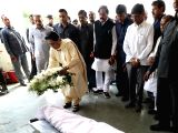 BSP chief Mayawati lays wreath on the mortal remains of party legislator Lalji Verma's son Vikas Verma who shot himself at his residence, in Lucknow on March 14, 2018.