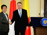 BUCHAREST, Jan. 17, 2018 - Romanian President Klaus Iohannis (R) shakes hands with visiting Japanese Prime Minister Shinzo Abe in Bucharest Jan. 16, 2018.