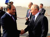 CAIRO, Dec. 11, 2017 - Egyptian President Abdel-Fattah al-Sisi (L, front) welcomes his visiting counterpart Vladimir Putin (R, front) in Cairo, Egypt on Dec. 11, 2017.