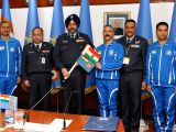 Chief of the Air Staff, Air Chief Marshal BS Dhanoa hands over the ice-axe baton with Indian and Air Force Flag to Gp. Capt. RC Tripathi, leader of the Mountaineering Expedition Team to ...