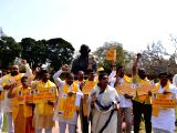 Congress MP Renuka Chowdhury looks on as TDP MPs stage a demonstration to press for special economic status for Andhra Pradesh at Parliament in New Delhi on March 19, 2018.