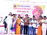 Cricket legend Sachin Tendulkar felicitates children in Donja village in Osmanabad district of Maharashtra on Dec 19, 2017. The Rajya Sabha MP had come on his maiden trip to review the ...