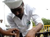 Dabbawalas tag messages on the lunch boxes after joining hands with World Health Organisation to draw attention of the people towards prevention and control of vector-borne diseases in Mumbai on ...