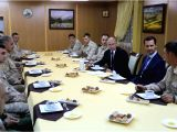 DAMASCUS, Dec. 11, 2017 - Syrian President Bashar al-Assad (2nd R) and his Russian counterpart Vladimir Putin (3rd R) attend a meeting in the Russian-run Hmeimim Air Base in the coastal city of ...