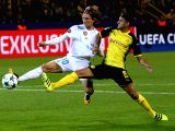 DORTMUND, Sept. 27, 2017 - Luka Modric (L) of Real Madrid vies with Mahmoud Dahoud of Dortmund during the UEFA Champions League group H match at Signal Iduna Park on Sept. 26, 2017 in Dortmund, ...