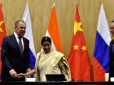 External Affairs Minister Sushma Swaraj, her Chinese counterpart Wang Yi and Russian counterpart Sergei Lavrov join hands afer the Russia-India-China Foreign Ministerial joint press ...