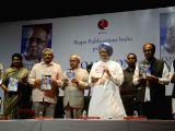 Former President Pranab Mukherjee, Former Prime Minister Dr. Manmohan Singh, DMK leader Kanimozhi and Samajwadi Party chief Akhilesh Yadav at the launch of The Coalition Years ...