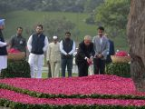 Former President Pranab Mukherjee pays floral tributes to former Prime Minister Indira Gandhi on her birth centenary in New Delhi on Nov 19, 2017. Also seen Congress Vice President Rahul ...