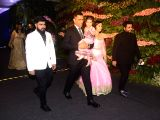 Indian cricketer Mahendra Singh Dhoni along with his wife Sakshi Dhoni and daughter Ziva Dhoni at the wedding reception of Indian cricket captain Virat Kohli and actress Anushka Sharma in ...