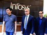 Infosys CEO Salil Parekh, CFO MD Ranganath and COO Praveen Rao arrive to attend company's Q3 results at Infosys campus, in Bengaluru on Jan 12, 2018.