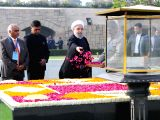 Iranian President Hassan Rouhani pays floral tributes at the Samadhi of Mahatma Gandhi in Rajghat of Delhi on Feb 17, 2018.