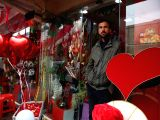 KABUL, Feb. 14, 2018 - An Afghan vendor waits for customers at his shop on Valentine's Day in Kabul, capital of Afghanistan, on Feb. 14, 2018.