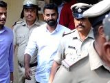 Karnataka Congress legislator N.A. Haris' son and expelled state Youth Congress leader Mohammed Nalapad being taken to be produced before a court from Cubbon Park police station in ...