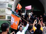 : Kolkata: BJP workers stage a demonstration against West Bengal Government outside Election Commission Office in Kolkata, on Dec 21, 2017. The party accused the Trinamool of not letting its polling ...