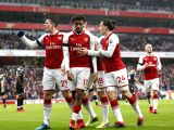LONDON, Jan. 21, 2018 - Alex Iwobi (2nd L) of Arsenal celebrates with his teammates during the English Premier League football match between Arsenal and Crystal Palace at the Emirates Stadium in ...