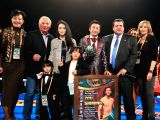 LOS ANGELES, Feb. 25, 2018 - China's boxer Zou Shiming (4th R) poses with his family and Mauricio Sulaiman(3rd, R), the President of the World Boxing Council (WBC) in Los Angeles, the United States, ...