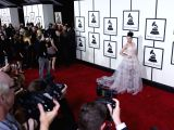 Katy Perry arrives on the red carpet for the 56th Grammy Awards at the Staples Center in Los Angeles, the United States, on Jan. 26, 2014.  (Xinhua/Yang ...