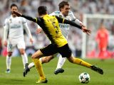 MADRID, Dec. 7, 2017 - Mateo Kovacic(R) of Real Madrid breaks through during the UEFA Champions League group H football match between Real Madrid CF and Borussia Dortmund at the Santiago Bernabeu ...