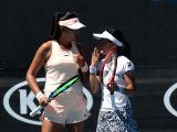 MELBOURNE, Jan. 18, 2018 - Yang Zhaoxuan (L) of China and Aoyama Shuko of Japan comunicate during the womens doubles first round match against Taylor Townsend of the U.S. and Renata Voracova of the ...