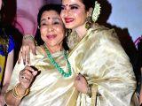 :Mumbai:  Bollywood playback doyenne Asha Bhosle and actress Rekha at the