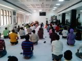People practice Yoga Asans -postures- on International Yoga Day at Delhi High Court on June 21, 2017. (