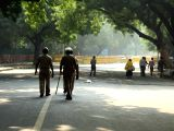 Police deployed as NDMC staff remove makeshift and permanent structures from Jantar Manatar in New Delhi on Oct 30, 2017. The National Green Tribunal (NGT) has ordered a stop to all ...