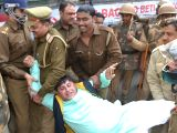 Police detains a Congress worker protesting against BJPs Yuva Udghosh programme in Varanasi on Jan 20, 2018.