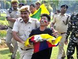 Police take away Tibetan protesters demonstrating against Chinese President Xi Jinping near the Chinese Embassy in New Delhi on Oct 18, 2017.