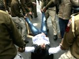 Police take away Youth Congress activists demonstrating against PNB scam in New Delhi on Feb 16, 2018.