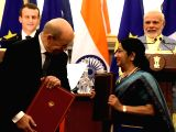 Prime Minister Narendra Modi and French President Emmanuel Macron witnesses as External Affairs Minister Sushma Swaraj exchanges agreements between India and France, at Hyderabad House, in ...
