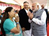 Prime Minister Narendra Modi greets Rajasthan Chief Minister Vasundhara Raje at swearing ceremony of the council of ministers of the Gujarat Government in Gandhinagar on Dec 26, 2017.