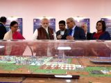 Prime Minister Narendra Modi, Union Pteroleum Minister Dharmendra Pradhan and Rajasthan Chief Minister Vasundhara Raje at an exhibition in Barmer Refinery in Rajasthan on Jan 16, 2018.