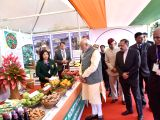Prime Minister Narendra Modi walks through the exhibition of farm produce of North-East and display of relevant farm and non-farm technologies at Assam Rifles Cant, Aizawl on Dec 16, 2017. ...