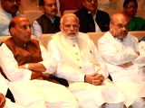 Prime Minister Narendra Modi with party president Amit Shah (R) and Rajnath Singh (L) at BJP parliamentary party meeting at Parliament House on March 13, 2018.