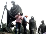 Rebel Aam Aadmi Party MLA Kapil Mishra and BJP MLA Manjinder Singh Sirsa stage a demonstration by placing mask on the statue of Mahatma Gandhi against alleged lack of spending by the ...