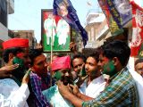 Samajwadi Party (SP) and Bahujan Samaj Party (BSP) workers greet each other, outside a counting center in Allahabad on March 14, 2018. SP on Wednesday took winning leads in both the Lok ...