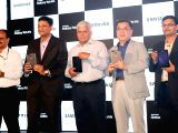 Samsung India electronic, senior vice president Ken Kang, vice president Sukesh Jain, and TRAI chairman RS Sharma during the launch of Samsungs first iris recognition-powered tablet in ...