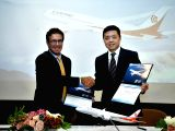 SAN FRANCISCO, Nov. 23, 2017 - Li Zongling (R), president of Okay Airways, and Boeing Commercial Airplanes Global Sales and Marketing Senior Vice President Ihssane Mounir shakes hands during a ...