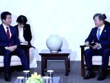 South Korean President Moon Jae-in (R) holds talks with Japanese Prime Minister Shinzo Abe in the South Korean alpine town of PyeongChang on Feb. 9, 2018. The talks came ahead of the ...
