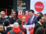 TBILISI, Feb. 8, 2018 - Former French player Christian Karembeu (2nd L) and Georgian football star Kakha Kaladze (3rd L) gesture as they present the FIFA World Cup Trophy during a ceremony in ...