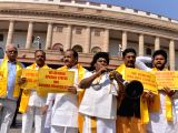 TDP MPs stage a demonstration to press for special status for Andhra Pradesh at Parliament in New Delhi, on March 12, 2018.